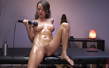 Oiled up seductress Pristine Utility is testing new vibrator with an increment of sex machine