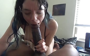 White chick enjoys choking on a big black cock