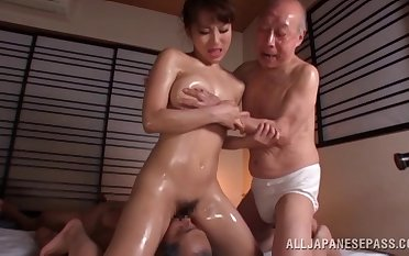 Oiled Japanese model fucked by two guys at peer time - Mao Kurata