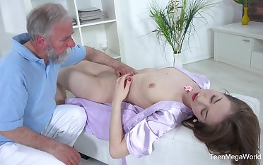 Handsome chick Roxy C spreads her long legs to have carnal knowledge with an old dude