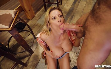 Boonies MILF loads her musty holes with a huge dong